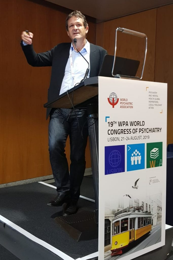 Dr. Paul Koeck, MD speaking at the19th World Congress of Psychiatry 2019, Lisbon about his reasearch